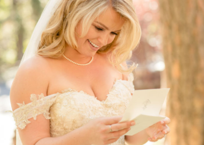 cute bride reading letter from loved one