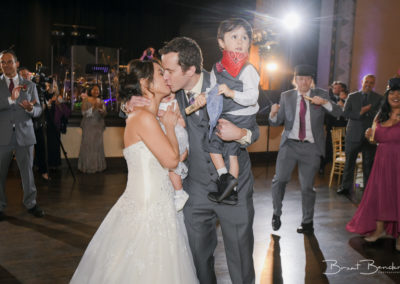 cute bride and groom and kids kiss brant bender photography