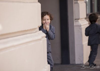 cute candid bride young son waiting to see mom bride brant bender photography