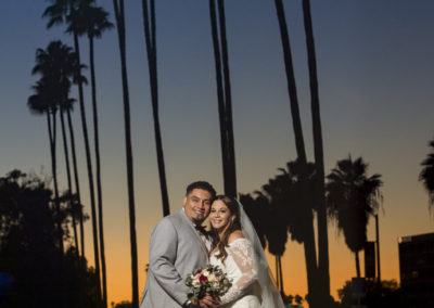 beautiful sunset backdrop for bride and groom kissing